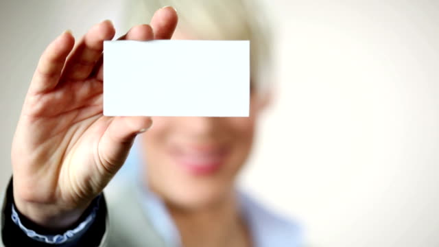 Businesswoman showing card.