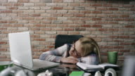 Businesswoman sleeping at the office
