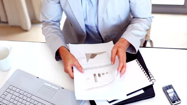 Businesswoman sorting through paperwork