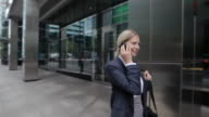 Businesswoman speaking on cellphone in city street