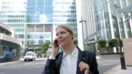 Businesswoman speaking on cellphone in city