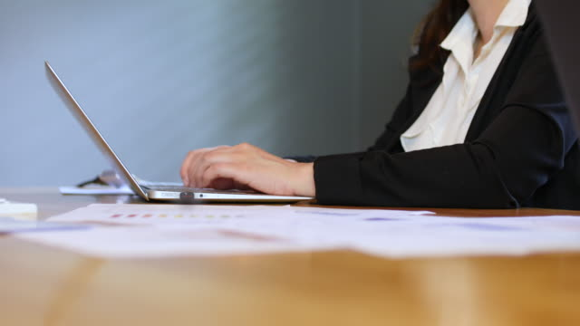 Businesswoman Typing On Laptop Keyboard