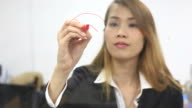 Businesswoman use phone and writing on 'WIFI' on glassglass