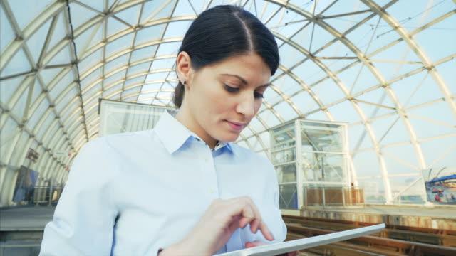 Businesswoman using a digital tablet.