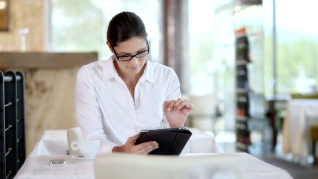 HD DOLLY: Businesswoman Using Digital Tablet At The Café