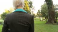 HD STEADY SHOT: Businesswoman Using Digital Tablet In Park