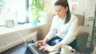 Businesswoman using laptop in the cafe.