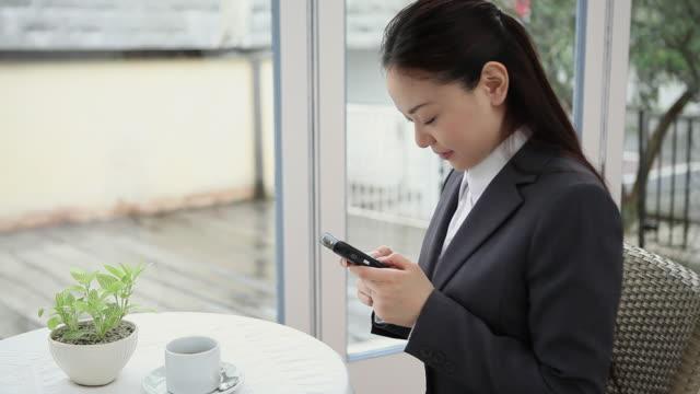 MS Businesswoman using mobile phone / Shibuya, Tokyo, Japan.