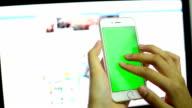 Businesswoman using smart phone touchscreen.