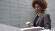 Businesswoman using smartphone and on the move