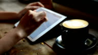 Businesswoman Using Tablet At Coffee Shop