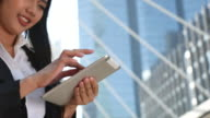 businesswoman using Tablet in City, Close up