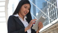businesswoman using Tablet in City