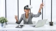 Businesswoman using VR glasses working with vr virtual reality