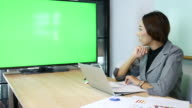 Businesswoman Video conference meeting with Green screen