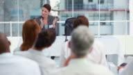 Businesswoman welcoming a speaker