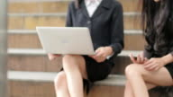 4K : businesswoman working at laptop for working outdoor.