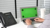 Businesswoman Working on a Laptop with Green Screen
