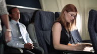 Businesswoman working on aeroplane