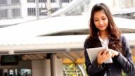 Businesswoman working on digital tablet