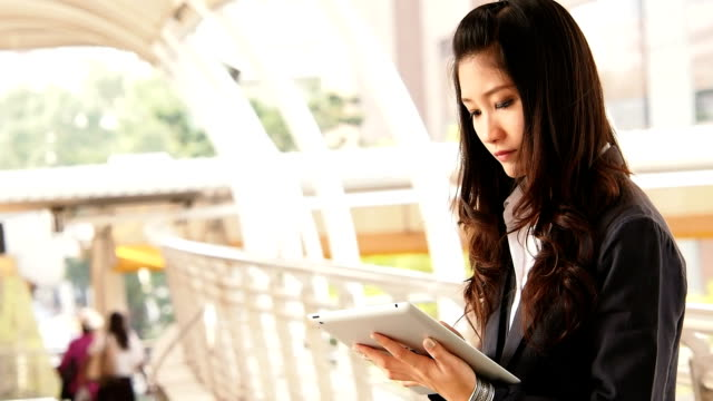 Businesswoman working on digital tablet