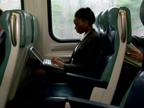 MS, Businesswoman working on laptop in train, Chappaqua, New York State, USA