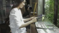 Businesswoman working on tablet computer in home