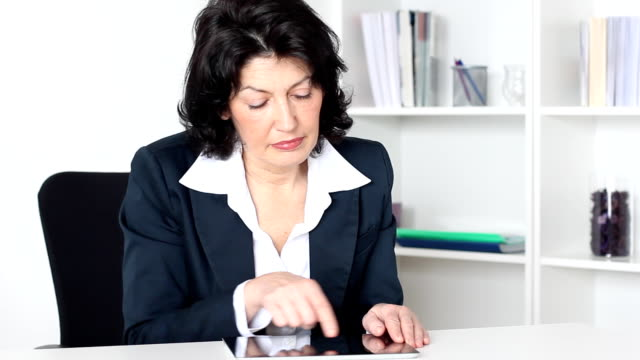 Businesswoman  working on tablet computer.