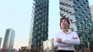 MS SLO MO PAN Businesswomen standing behind building / Incheon, South Korea