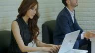 Businesswomen Using Laptop In Coffee Shop