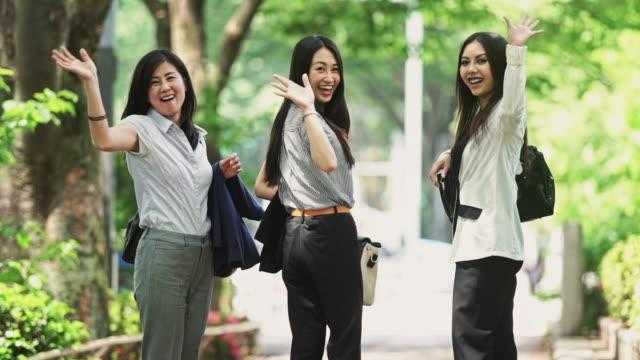 Businesswomen Waving