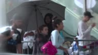 Busloads of evacuatees arrive at a hurricane shelter at the Houston Convention Center
