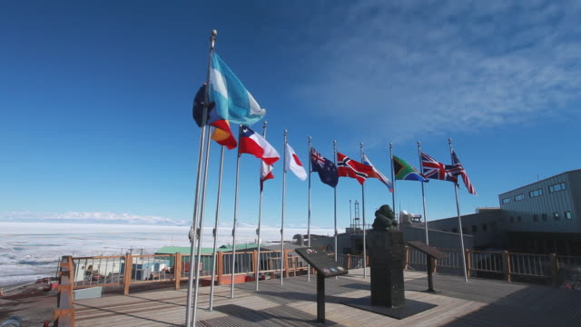 Bust of Admiral Byrd and flags, McMurdo Base, Antarctica