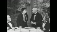Buster Keaton joins a table of scientists at a restaurant and lies in order to get a job