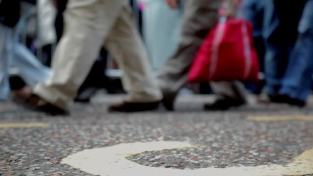 Bustling feet in street