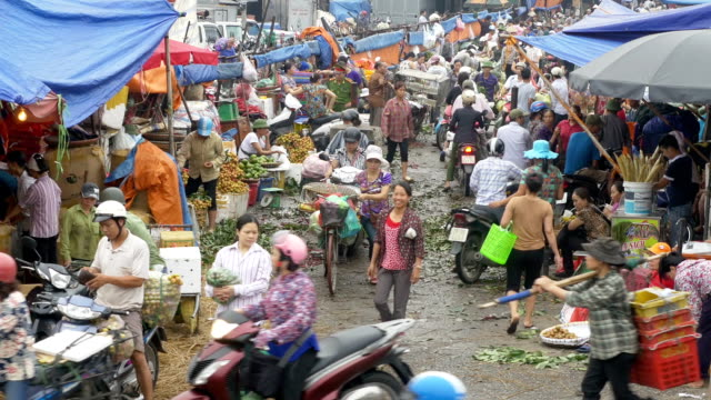 Busy and chaotic wholesale food market in Hanoi Vietnam