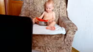busy baby eating watermelon and watching cartoons