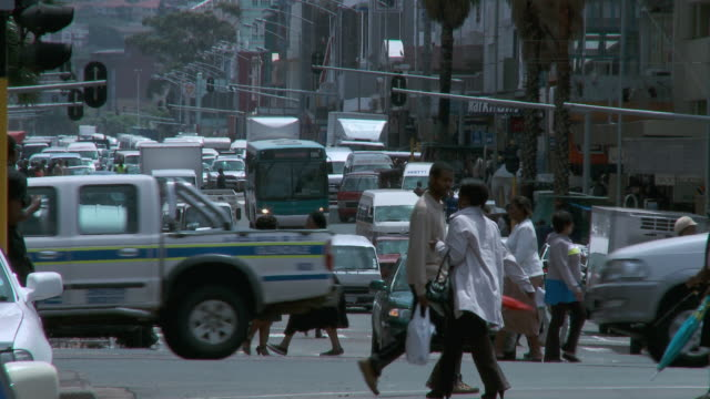 WS Busy city street crowded with cars and pedestrians / Durban, South Africa