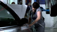 Busy Female Auto Mechanic