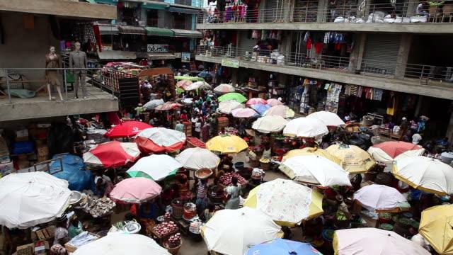 A busy market in Accra, Ghana where umbrellas protect vendors
