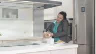 HD DOLLY: Busy Mother Preparing Breakfast