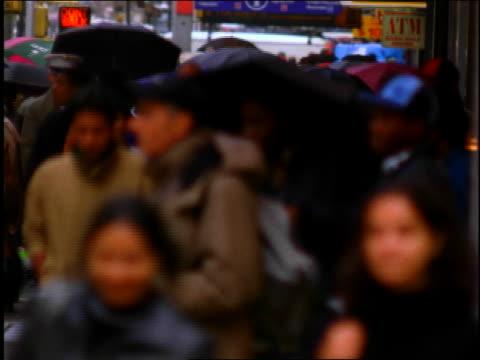 busy New York street on rainy day