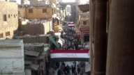 WS HA Busy shopping street in Khanal Khalili District, Egyptian flag hanging over street / Cairo, Egypt