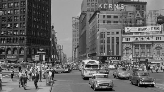1953 montage busy street scene oldsmobile dealership of used cars detroit michigan stock footage. Black Bedroom Furniture Sets. Home Design Ideas