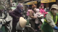 WS PAN Busy street scene with people riding mopeds / Hanoi, Vietnam
