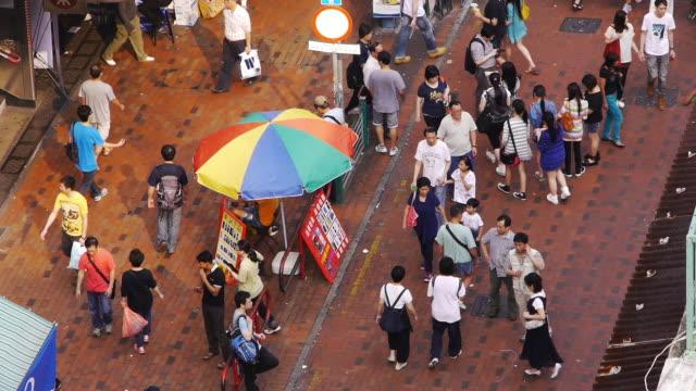 Busy Streetmarket in Sham Shui Po, Hong Kong. Medium wide shot, day