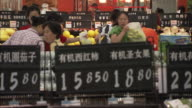 MS Busy supermarket scene with customers at checkout counters, Beijing, China
