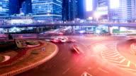 Busy traffic circle and pedestrian walking on footbridge at night,time lapse.