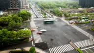 Busy traffic on crossroad in modern city,time lapse and tilt shift lens.