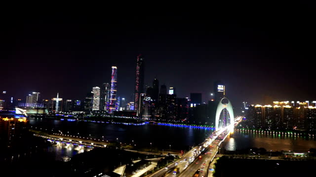 busy traffic through bridge in modern city guangzhou at night,timelapse.